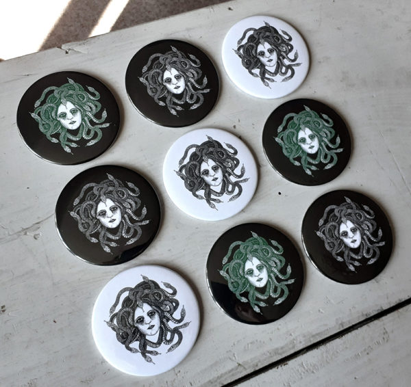 Set of pocket mirrors representing Medusa